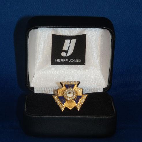 Gold pearl badge