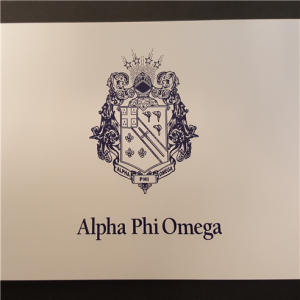 Note card with blue crest