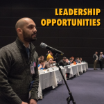 """brother at the microphone speaking at leadership event. Text at the top reads, """"Leadership Opportunities"""""""