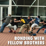 """bonding event with brothers playing tug of war. Text at the bottom reads, """"Bonding with fellow brothers"""""""