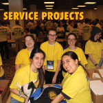 """group of members helping with convention service project. Text at the top reads, """"Service Projects"""""""