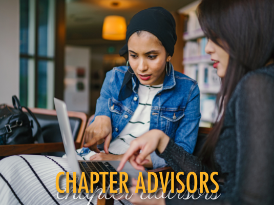 Advisor works with student on laptop in coffee shop.